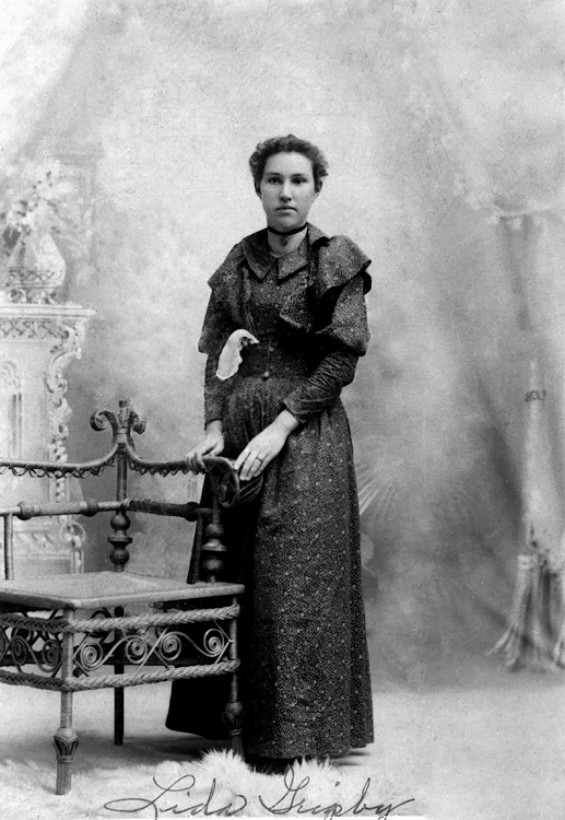 1896  - Lida Alma Graves Grigsby:  This photo of our Grandmother Grigsby was taken in the Opera House Building in Ottawa, Kansas.  Bill thinks that is a wedding ring on her left hand so she had married William Redman (December 31, 1895).  Lida was born in Streator, Illinois on March 24, 1878 so she would have been about 18 years old.  William Redman Grigsby was born on June 21, 1871 near Leon, Iowa and that would have made him 24 when they married.  Photo source is Lynnette Herring Fleming.