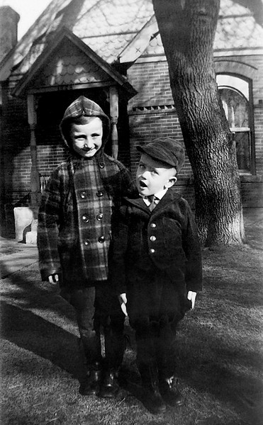 1940 - This photograph shows us standing in front of 1276 South Pennsylvania Street in about 1940.  It may be late in 1940 not too long before we moved to 2566 South Washington.  However, it could be early 1941 because Bill started the second semester of first grade at McKinley and then transferred to Rosedale and finished first grade there.  The photo shows what the front of 1276 looked like and it especially shows the big tree in the front yard that Bill remembers and is gone in the later<br /> photo h took in the 1970's.