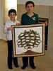 2008/11 - Jack and Ryan Carbone hold the genealogy wall hanging that Pat Grigsby made for Jim, Jodi, Tracee and Kendall.