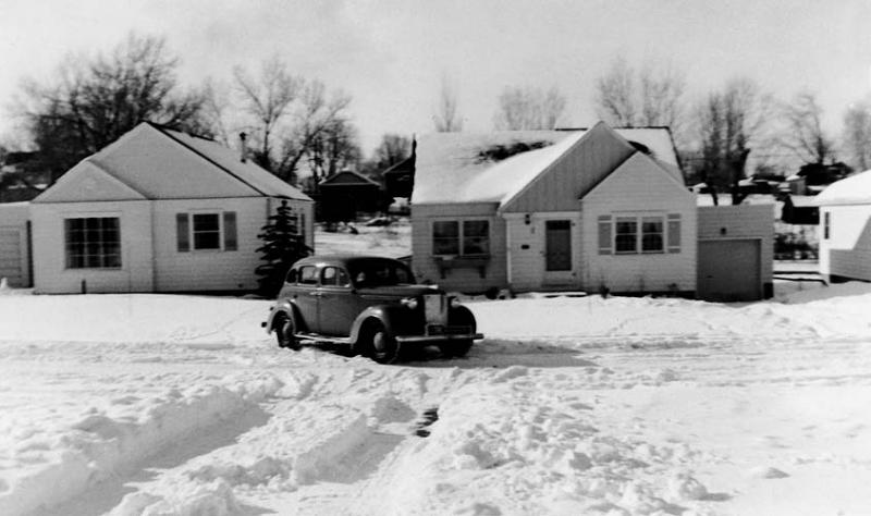 1942 - Dad's 1938 Plymouth:  1942 snow around the South Washington street neighborhood.  Houses left to right are Hansen's, Hauck's and Brown's.  Murry took this photo with a camera he got for Christmas and is still taking photos although he is now (2005) using the Canon 20D digital SLR.