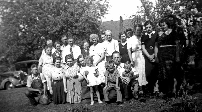 1941 - Staten Family Reunion somewhere in Iowa or Missouri.  Left to right, front row: Junior Staten (mom's brother), Lurena (Tilda's daughter), Doris (Tilda's daughter), Kathleen Staten Thompson, Betty Laws Woods (Tilda's daughter), Bill, dad and Murry.   Back row: uncle Bennett, Frankie Staten Bennett, Verna Mae Bechtel Staten, Chalmer Murry Staten, uncle Ray Staten, aunt Billie Staten (Ray's second wife), aunt Effie Staten Weldon Rowe, Marjorie Weldon Martin (Effie's daughter), our great grandfather Robert Edward Staten, aunt Tilda Staten Brewer Laws, uncle Henry Reece, aunt May Staten Reece, Arden Prevo, Pearl Brewer (mother of Kay Rickelman), Davie Brewer (Tilda's son), Pauline Reece Prevo and Jim Laws.  Mom probably took the picture because she's not in it.  That also looks likes Dad's 1938 Plmouth in the background.  Just a side note that Murry loved visiting uncle Bennett because he had trained his dogs to go get the cows from the fields and bring them home.  He also played a great Jew's (mouth) harp and kept it above the kitchen doorway.