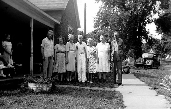 """1950 - This photograph was provided by Kathleen Staten and she remembered that Robert Edward Staten had broken his hip in 1950 and was living with aunt Effie in Bloomfield, Iowa at the time.  The people in the photograph are from left to right, Ray Staten, Tildie, Effie, Robert Edward on the crutches, Frankie, Mae and our grandfather, Chalmer (Josephine is the only one of our grandfather Chalmer's siblings missing from this photograph).  Bill remembers this gathering because he was 15 and grandpa Ed Staten was hobbling around on his crutches.  At the time Bill didn't appreciate that Ed had been born in 1862 (according to his head stone) and had married Lurena Elizabeth Taylor some time in 1885 because their first child, Alma Mae Staten, was born January 27, 1886.  Ed's first wife, Lurena, died in 1931.   Subsequently, Robert Edward was visiting cousins in Tarkio, Missouri and Emma Smith Brown, to whom he had been engaged in Tennessee in about 1883, was also visiting her sister near Tarkio.  They didn't recognize each other immediately but eventually they figured out who they were and would marry so their story at least had a brief happy ending.  Sadly, Emma Smith Brown Staten died in 1935 and is buried in a plot adjacent to the plot where Robert Edward and Lurena Staten are buried in the Downing, Missouri cemetery.  Robert Edward Staten died June 17, 1952.  Our mother, Elma Mae Staten Grigsby, is buried adjacent to her """"favorite grandmother,"""" Lurena Staten."""