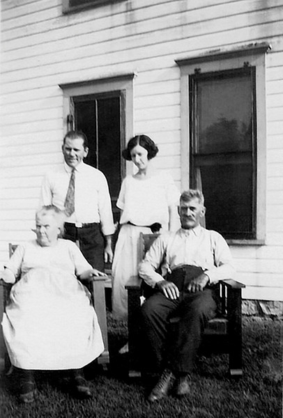 1924 - This photograph was given to Bill by Phyllis Grigsby Jones and was made on the same day as the previous photograph in 1924. The people from left to right are Eva Hester Graves, Bruce Graves, Helen Longsdorf Graves and George Selden Graves.  Bruce resided on his parents' farm in Ohio Township of Franklin County Kansas near Princeton in the 1910 census.  Bruce's obituary stated that he had moved to the Mansfield, Ohio area in about 1920 after his World War I service.  Bruce and Helen were married in Ohio in 1923.  This photograph may have recorded Helen's first trip to Kansas to meet her new family.  Helen was born in Mansfield, Ohio on September 17, 1899 and according to her obituary lived there her whole life.