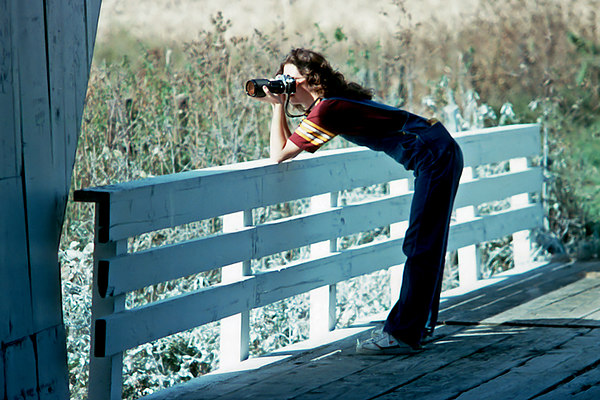 """1981/11 - Tracee shoots the bridges of Madison County in Winterset, Iowa during a November, 1981 trip with Murry, Pat and Bill.  This was before the covered bridges were discovered in Robert Waller's book, """"The Bridges of Madison County"""" in 1992 and subsequently made into a 1995 movie of the same name starring Clint Eastwood and Meryl Streep.  The above bridge may be the famous """"Roseman"""" bridge."""