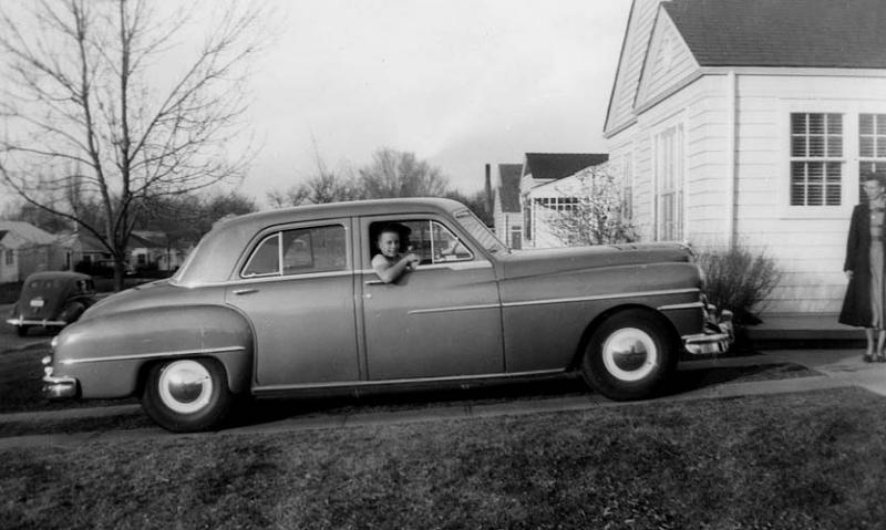"""1951 - Dad's 1951 DeSoto with mom watching:  This is the true meaning of """"No Fear"""" with me in the car as Bill backs out.  Burton's Ford is in the background.  Bill thinks the photo was shot around 1951 before mom and dad drove him and John Chapman to Dartmouth in 1952."""