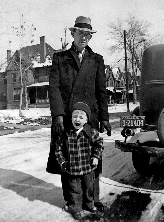 1938/01 - Dad and Bill.  A snowy day in perhaps January 1938 (see license plate) as Mom snaps a photo of Dad, Bill and the 1932 Plymouth.  Bill thinks this was near 200 West Irvington Place where we lived during our early years in Denver and is close to Leeman Auto Company at 6th and Broadway where dad was working as a book keeper.