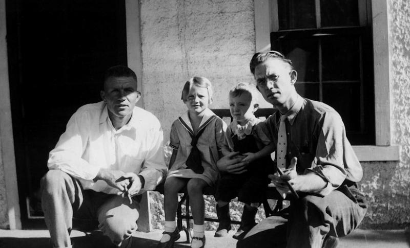1936 - Theodore, Lyda Margaret, Bill and Dad.  Theodore, one of Dad's brothers, was living at 2746 Williams Street in Denver with his daughter, Lyda Margaret, around the time of this photo (he was listed in the Denver directory at this address in 1935).  Bill was probably about 2 in this photograph -- why wasn't he smoking a cigar too?  Notice that Lyda Margaret has on the same dress as in the previous picture and Bill would have been 2 in October 1936 therefore, 1936 is a credible date for this and the previous photo.