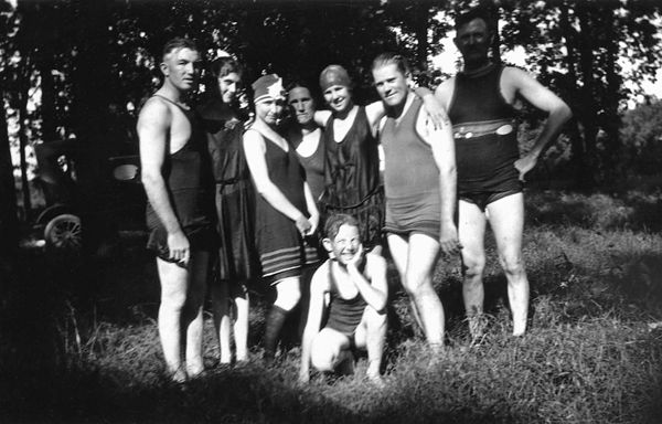 """1924 - After a dip in Fogle's pond:  Fogle's pond near Williamsburg, Kansas was the """"Old Swimming Hole"""" and left to right are Charles Grigsby, his wife Flossie, Helen Longsdorf Graves (who Murry and Bill called Aunt Helen), Lida Graves Grigsby (Dad's Mom), Hildreth Grigsby, Bruce Graves Sr. and William Redman Grigsby.  The squirt in front is Dad at about 14 years old.  Is that a cigarette in Charles' hand?"""
