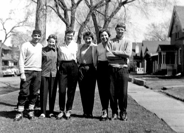 1957 - Dental Skiers:  The skiers include from left to right, Frank Ferson, Lorraine Fisher, Barbara Billinger, Beverly Sanford, Sue Benelli (all dental hygiene students at the University of Kansas City Dental School in Kansas City, Missouri) and Bill standing in front of Barbara's family home at 22 Sherman.  Lorraine and Bev had come to Denver with Barbara and Sue for Spring vacation and they're all headed to Winter Park for a day of skiing.