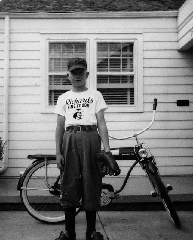 """1950 - Murry:  Decked out in my """"Richard's Fine Foods"""" (a drive-in restaurant at South Broadway and Vassar) baseball uniform with my Roadmaster bicycle in front of our spacious (700 square foot) house in South Denver.  Bill and I both played several years of """"Old Timers"""" youth baseball on the field at Cedar and Pearl."""
