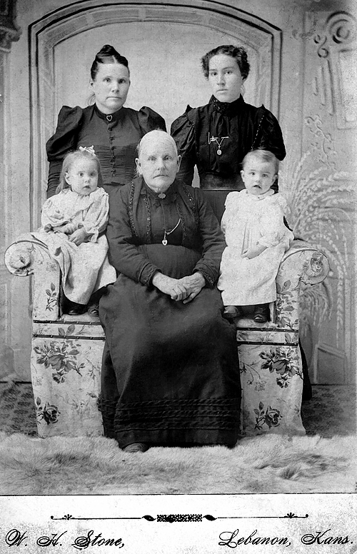 1897 - Thelma, Amanda, Charles (front row), Eva and Lida (back row):  This photograph was contributed by Phyllis Grigsby Jones who received it from her father, Charles Wayne Grigsby.  The woman sitting in the middle of the front row is Amanda Phibbs Hester and she is sitting between Thelma Graves and Charles Wayne Grigsby who were both born in 1896.  The women in the back row from left to right are Eva Hester Graves and Lida Alma Graves Grigsby.  Lida Alma, born in 1878, and Thelma are sisters and the daughters of Eva.  Charles is the first child of Lida Alma so Thelma is Charles' aunt.