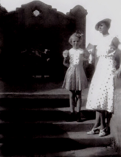 """1935 - This image was made at the same time as the previous picture and shows Wilma Jo Root Henderson with Flossie Greeve Grigsby.  According to Janie Root Eddy, Flossie and Phyllis traveled from Kansas to Albuquerque to visit Hildreth, Janie, Wilma Jo and Chet because they lived in the Albuquerque area at the time.  A copy of the original photo was provided by Janie Root Eddy and she identified the building in the background as the railroad """"Depot"""" in Albuquerque that was built around 1902 in the Spanish Mission style and is still in use."""