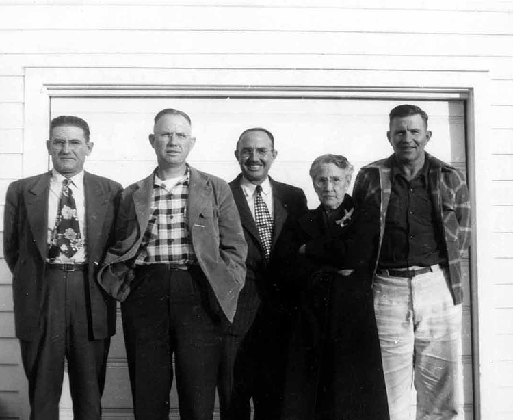 1944 - Walter, James, Charles, Lida, Theodore Grigsby:  This is Lida and her boys around 1944 in front of 2566 So. Washington, Denver, Colorado our boyhood home.  James Maurice Grigsby (second from left) was our father.
