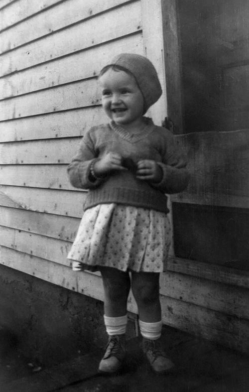 """1932 - Anna Maree Grigsby.  Sister Ann at two years and two months old somewhere around Williamsburg, Kansas probably at the home of Ann's Blair grandparents.  On the back of the picture in pencil, it reads: """"Makin' eyes at Grandma!  2 years and 2 months, Anna Maree.""""  Grandma in this photo caption had to be Neva's mother, Ann's grandmother Blair."""