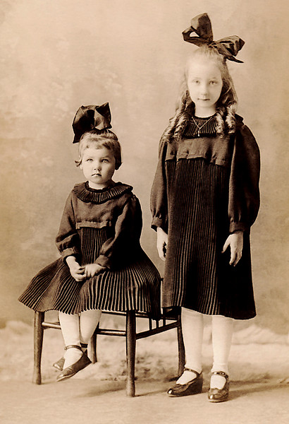1922 - This is a photo of mom and her sister, Inez.  It is actually a picture postcard but there is no name of the photographer, where it was taken, or who manufactured the postcard.  Bill is guessing that Inez is 6 (she was born in 1916 and died in 1934) and mom is about 10 (she was born in 1912).  He also is guessing the photo was taken when they lived in Missouri (Downing?) in about 1922 before the depression.  Mom said she started school at the Hall School near Kilwinning, Missouri (not too far from Downing, i.e., about 3 miles as the crow flies).   Anyway, the little girls have some pretty fine clothes, shoes and hair ribbons -- maybe great grandfather Ed Staten (or great grandmother Lurena Staten) contributed to the outfits?  Elma already shows her interest in necklaces -- at least Bill seems to remember that she had a penchant for necklaces as an adult?  As it should be, the older sibling gets preferential treatment -- notice Inez has no necklace!