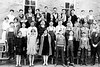 """1928 - Mom wrote on the back of the photo: """"Freshman Class 1927-1928 term"""" """"23 boys - 14 girls  - Total 37""""  This photograph is similar to the one that appears in the 1928 Williamsburg High School yearbook, the Progressus, and both pictures show Elma Staten and Neva Blair, the loves of our father's life, in this class.  Elma Staten is in the front row second from the left and Neva Blair is in the third row directly behind the boy behind Elma.  The write-up in the Progressus says that this was the largest class ever to enroll at Williamsburg High School up to that time with 38 students in September 1937 but there are only 37 in this picture (Glenn Godsey died in the fall semester) and by spring 1928 they were down to 32 students.  Dad was a junior in the 1928 Progressus.  His class had 19 students in it and he was the president of the class.  He wrote in his copy of the 1928 Progressus that he had been the class president in 1926 to 1927, 1927 to 1928 and 1928 to 1929 (so Murry came by his political talents honestly [Grant Jr. High class president for 7th and 8th grades and head boy at Grant in 9th grade]).  Bill has 2 copies of the 1928 Progressus (one mom's and one dad's) and 2 copies of the 1931 Progressus when mom graduated (one mom's and the other one has the cover torn off -- Neva's?).  Neva is not included in the 23 graduating seniors in the 1931 Progressus so she didn't graduate with her class because she married dad on February 1, 1930 and Anna Maree was born on September 7, 1930.  Neva and dad were divorced on December 1, 1933.  Dad married mom on April 27, 1934 and Bill was born in 1934 and Murry in 1937.  In the May 1967 Williamsburg High School Alumni Directory, Neva  Blair Harding was listed with the class of 1932's thirty graduates and she lived in Granger, Utah at that time.  In the 1974 Alumni Directory, Neva lived in Emporia, Kansas.  Neva was killed during a tornado near Topeka, Kansas on June 8, 1974.  Neva Blair Harding is buried with her parents"""