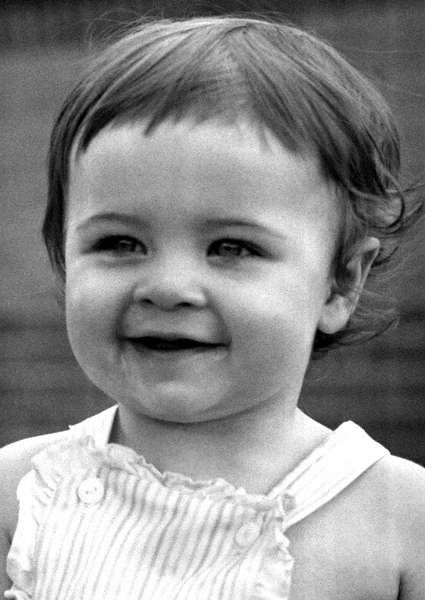 "1961 - The other ""twin"" cousin:  Tracee Grigsby smiling during the Fathers Day celebration at mom and dad's house on East Yale.  Tracee and Janet were born on the same day in August 1959."