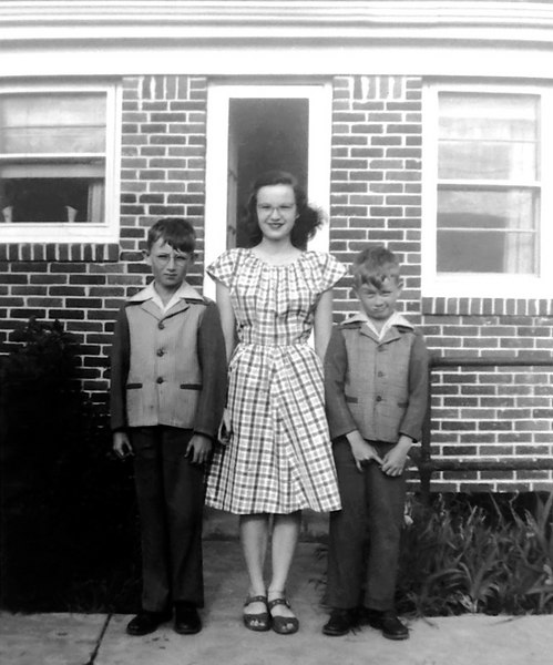 """1945 - This photo shows Bill, Anna Maree and Murry Grigsby. Dad and mom came driving down South Broadway in the 1938 Plymouth to pick us up from a baseball game at Merchant's Park and there was Ann and her friend Kate!  That was the first time we knew that we had a sister!  The picture must have been taken in about the summer of 1945 so Bill would have been 10 (11 in October 1945) and Murry would have been 8.  Bill started wearing glasses in 5th grade so he had finished 5th grade in the spring of 1945.  It is remarkable that Ann is still smiling even after learning that she's related to the 2 """"duffis"""" brothers -- must be a measure of her tolerance!  Picture thoughtfully provided by Jim Miers."""