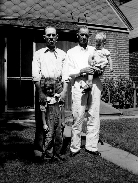 1939 - Dad, Bill, Chalmer and Murry.  The back yard of 1276 South Pennsylvania where we moved in time to be in the 1938 Denver Directory.  Bill started nearby McKinley Elementary school in the fall of 1940.  Bill was five and Murry two in 1939.  Check out Dad's cigar and ears :0)  Left to right: James Maurice Grigsby, William Redman Grigsby, Chalmer Murry Staten (mom's Dad) and Murry Chalmer Grigsby.  Bill says he can remember ice and coal deliveries and no central heat or hot water heater in the house.  Looks like Dad was growing tomatoes next to the house.