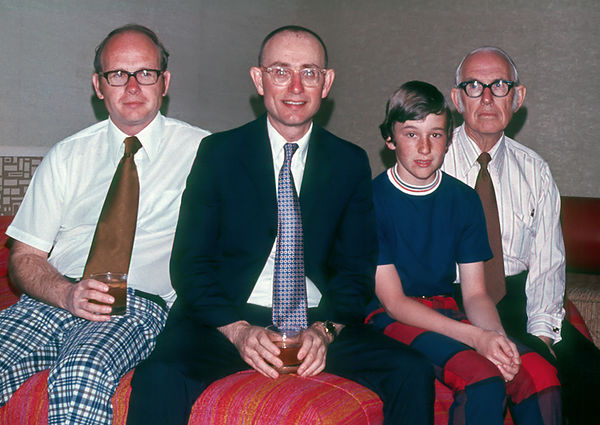 1973/03 - Trip to Disney World--Murry, Bill, James and Dad:  Guess who the designated driver is?  Was it the booze or the sun that got the noses of the Grigsby boys?  It is a bad sign when you have your tie in your drink!