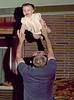 1960 At mom and dad's house on Yale in Denver.  Bill tosses Tracee up high.