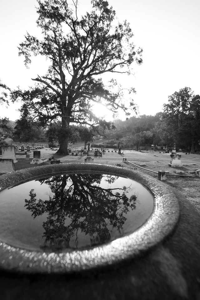 Cedar Hill Cemetery in Vicksburg, Mississippi. The whole symbolism of reflecting on your life while standing in a cemetery was going through my mind as I grabbed this shot. Some photos just scream for Black and White! These Mississippi Delta photos are no exception. Southern cemetery's provide some great opportunities for photos. Oh what beautiful photos we get when we mix that Southern water with a southern sunrise or sunset!