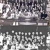 F0145 <br /> Zanguitvoering van de zangvereniging De Lofstem en het kinderkoor De Juichende Kinderschaar. De Lofstem is opgericht in 1923 en viert in 1998 het 75-jarig bestaan. Waarom de heren Van Goeverden en De Kwaasteniet een zilveren speld dragen is niet bekend. De vereniging bestond toen 15 jaar, dus geen jubileum. Foto: ca. 1938.<br /> <br /> 1Jo Esseveld<br /> 2Jo Oudshoorn<br /> 3Piet Couvee<br /> 4Arie Koppier<br /> 5dhr. A. van Duyvenbode<br /> 6Jan Esseveld<br /> 7Leen Sluymer<br /> 8Arie Koster (kapper)<br /> 9Wim Koot, Warmond<br /> 10Jan van Pijpen<br /> 11Thea van Eeuwen<br /> 12Nel van der Hulle<br /> 13Els van Duyvenbode<br /> 14Wil de Kwaasteniet<br /> 15Riek Aangeenbrug<br /> 16Truus Verschoor<br /> 17Maartje de Kwaasteniet<br /> 18Nellie Voorsluys<br /> 19Corrie van Duyvenbode<br /> 20Jo Esseveld<br /> 21Alie van Biezen<br /> 22Bets Filippo<br /> 23Jo Couvee<br /> 24Teuni Blijleven<br /> 25Klarie van Duyvenbode<br /> 26Guurtje van Goeverden<br /> 27Jannie de Kwaasteniet<br /> 28Jo van Goeverden<br /> 29Maartje van der Voort<br /> 30Mien Heijns<br /> 31Henk Sluymer<br /> 32Dirk Molema<br /> 33Cor van Goeverden (met zilveren speld)<br /> 34dhr. Van der Keur (dirigent)<br /> 35Arie G. de Kwaasteniet (met zilveren speld)<br /> 36Nico Overvliet<br /> 37Trijntje van Steensel<br /> 38mevr. Koster<br /> 39Bep Bakker<br /> 40Sjaan van der Voort<br /> 41Jo Koppier<br /> 42<br /> 43Leida Filippo<br /> 44<br /> 45Willy Philippo<br /> 46Hennie Oudshoorn<br /> 47Hannie Both<br /> 48Stien van der Hulle<br /> 49Riet Schmohl<br /> 50Riet Filippo<br /> 51Jo Knetsch<br /> 52Nel Knetsch<br /> 53Ina Aangeenbrug<br /> 54Alie Molema<br /> 55Annie Esseveld<br /> 56Rina van der Bent<br /> 57Mary van der Meer