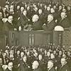 F1201a <br /> Bij eenkomst t.g.v. de plechtige opening van het gemeentehuis van Sassenheim op vrijdag 17 januari 1930<br /> <br /> 01<br /> 02<br /> 03 P.J. Vercouteren (hoofd Chr. ULO-school)<br /> 04 J.O. Matze (hoofd RK jongensschool)<br /> 05<br /> 06 J. Wiepkema (hoofd School met den Bijbel)<br /> 07 <br /> 08Dr. P. le Grand (arts)<br /> 09<br /> 10Dr. O.W. de Boeff (arts)<br /> 11<br /> 12<br /> 13J. Baak (inspecteur lager onderwijs)<br /> 14P. van Deursen<br /> 15<br /> 16<br /> 17Th. Bader Hnz.<br /> 18<br /> 19<br /> 20<br /> 21<br /> 22Henriette van Zonneveld (dochter van H. van Zonneveld)<br /> 23Kaja Warnaar (dochter van A Warnaar Jzn.)<br /> 24<br /> 25<br /> 26L. van Leeuwen  <br /> 27J. Heemskerk<br /> 28<br /> 29<br /> 30A. Frijlink<br /> 31Ds. P.D. Kuiper (Geref. predikant)<br /> 32<br /> 33Ds. W.G. Krijkamp (Ned. Herv. predikant)<br /> 34J.A.H. Thus (pastoor)<br /> 35J. Velthuyse (kapelaan)<br /> 36Pater Verhaar O.F.M.<br /> 37W. Los (gemeente-secretaris)<br /> 38H. Bader (wethouder)<br /> 39J.P. Gouverneur (burgemeester)<br /> 40H. van Zonneveld (raadslid)<br /> 41J.A.A. van der Geest (raadslid)<br /> 42A.J. Verkleij (raadslid)
