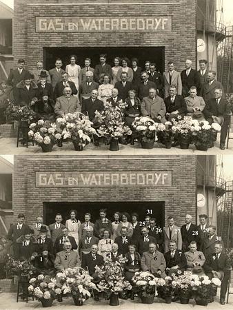 F1569<br /> Feestelijke bijeenkomst vóór het Gas- en Waterleidingbedrijf  in de Molenstraat. Foto: 1932.<br /> <br /> 01mevr. Gouverneur<br /> 02J.P. Gouverneur<br /> 03<br /> 04<br /> 05<br /> 06H. Bader<br /> 07dhr. Los?<br /> 08dhr. Hubers<br /> 09J.P. Oudshoorn<br /> 10<br /> 11<br /> 12K.W. van Breda<br /> 13G. Dannijs<br /> 14<br /> 15<br /> 16<br /> 17dhr. Boogaards<br /> 18M. van Breda<br /> 19W. Verhoog<br /> 20<br /> 21<br /> 22<br /> 23<br /> 24<br /> 25<br /> 26<br /> 27<br /> 28<br /> 29dhr. Berk<br /> 30<br /> 31