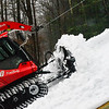 KRISTOPHER RADDER — BRATTLEBORO REFORMER<br /> Alan Robinson, Mount Snow winch cat operator, pushes the snow around to create a smooth landing at the Harris Hill Ski Jump on Tuesday, Feb. 11, 2020.