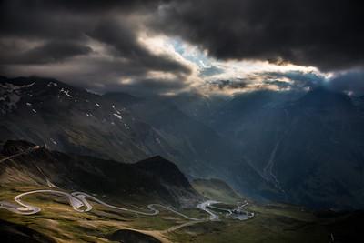 Alpine valley, high mountain roads in sunset