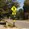 NASHOBA VALLEY VOICE/ANNE O'CONNOR<br /> Groton will see more solar-powered crosswalk safety signs like this one that was installed in front of the library by Lawrence Academy. The signs and other transportation improvement will be paid for by a Complete Streets state grant.