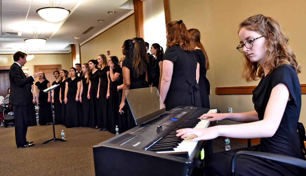 . Groton Dunstable Chamber Choir performing at the Leominster Public Library, playing a peice on the piano is Taryn Emerle 17 during one of the songs. SUN/ David H. Brow