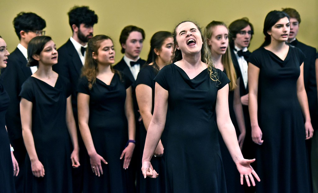 . Members of the Groton Dunstable Cahmber Choir perform at the Leominster Public Library, in front doing a solo is Hannah Loomis 17 and a senior. SUN/ David H. Brow