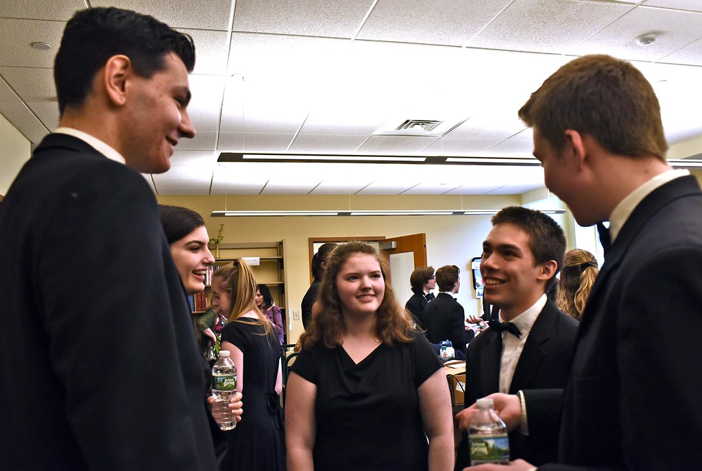 . Having a backstage chat before heading out to performing at the Leominster Public Library are members of the GD Chamber Choir L-R, Matthew Suchecki 18, Abby Flaherty 18, Emily Rimkus 15, Matthew Liliedahl 17 and Josh Booth 16. SUN/ David H. Brow