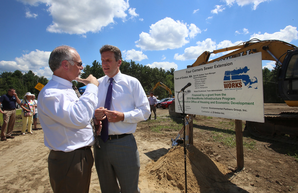. Groundbreaking ceremony for the Four Corners MassWorks Infrastructure Project, at the intersection of Rt 119 and Rt 225 in Groton. Groton town manager Mark Haddad, left, and EOHCD secretary Jay Ash. (SUN/Julia Malakie)