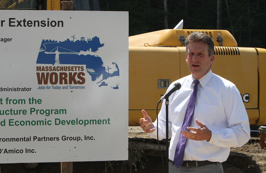 . Executive Office of Housing and Community Development secretary Jay Ash speaks at the groundbreaking ceremony for the Four Corners MassWorks Infrastructure Project, at the intersection of Rt 119 and Rt 225 in Groton. (SUN/Julia Malakie)