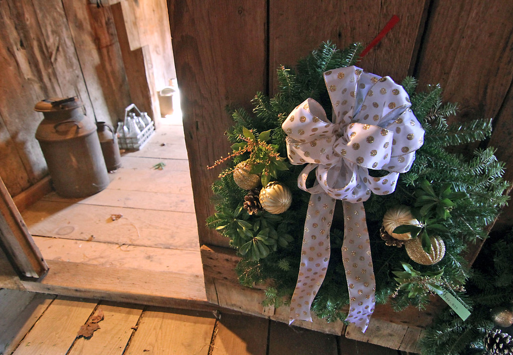 . Shown here in the Williams Barn in Groton is one of many holiday wreaths made by members of the Grotons Womens Club for their annual sale. Nashoba Valley Voice /David H. Brow