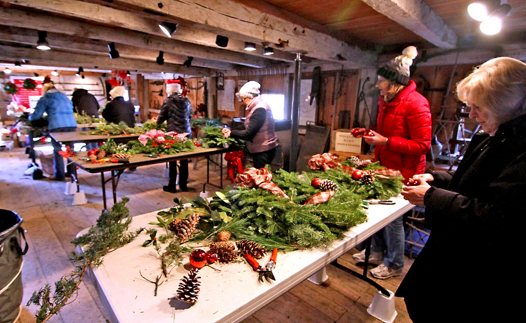 . Members of the Groton Womens Club working  in Williams Barn on holiday wreaths for the upcoming Greens Sale. Nashoba Valley Voice /David H. Brow