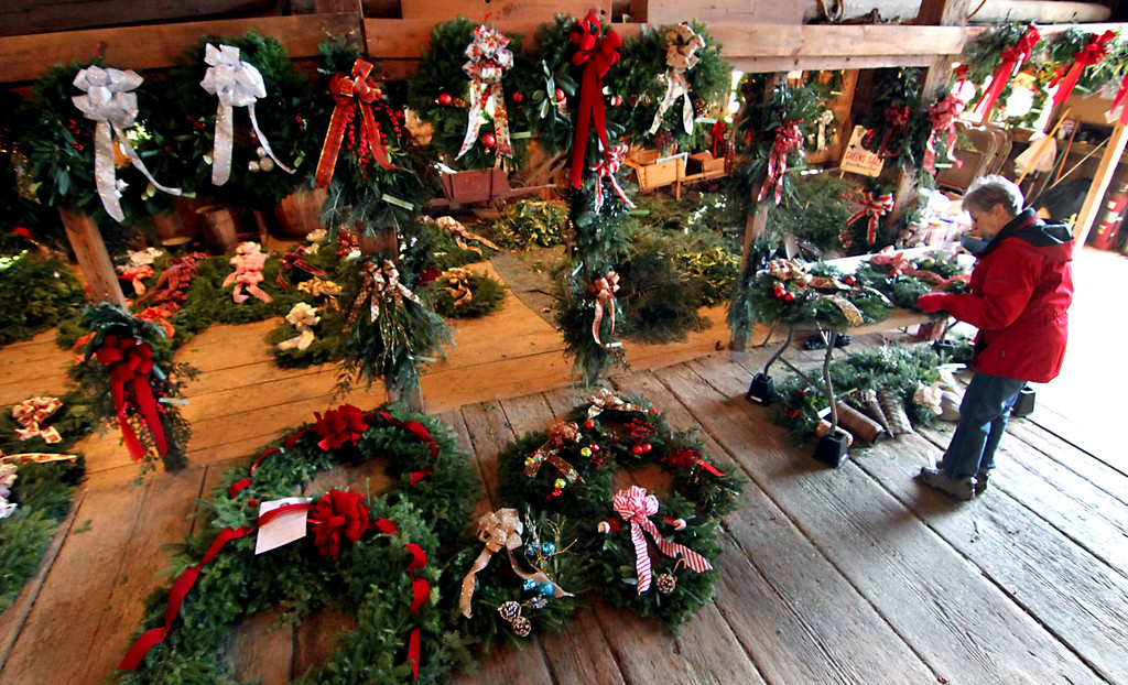 . Ahuge array of holiday wreaths and swags made by the members of the Groton Womens Club for their annual Greens Sales, on right is member Pat Bennett. Nashoba Valley Voice /David H. Brow