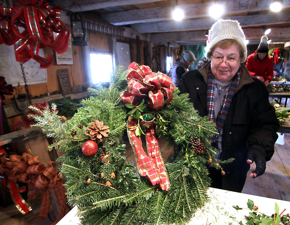 . Groton Womens Club member Carole Carmichael of Groton, shows the holiday wreath she just made for the clubs annual Greens Sale. Nashoba Valley Voice /David H. Brow
