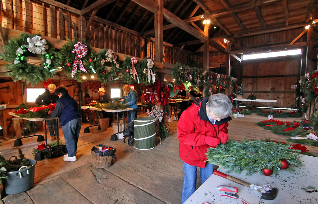 . Groton Womens Club members work on holiday wreaths and swags for their annual Greens Sale, in front on right is Pat Bennett of Groton. Nashoba Valley Voice /David H. Brow