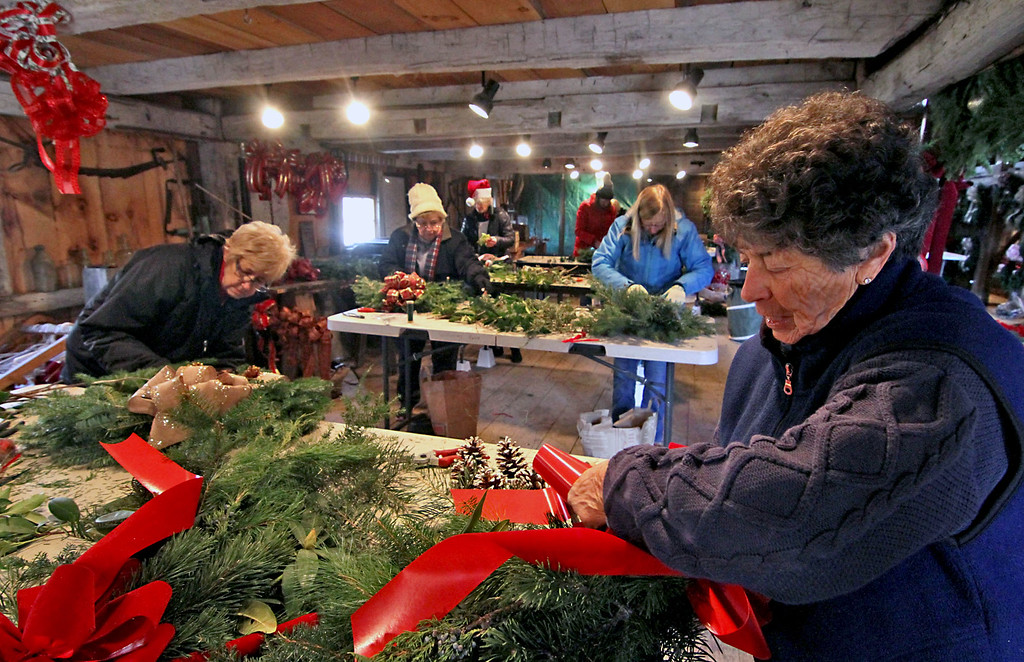 . Members of the Groton Womens Club are very busy at making wreaths and swags for their annual Greens Sale, in front on right is Peg Wheatley of Groton. Nashoba Valley Voice /David H. Brow