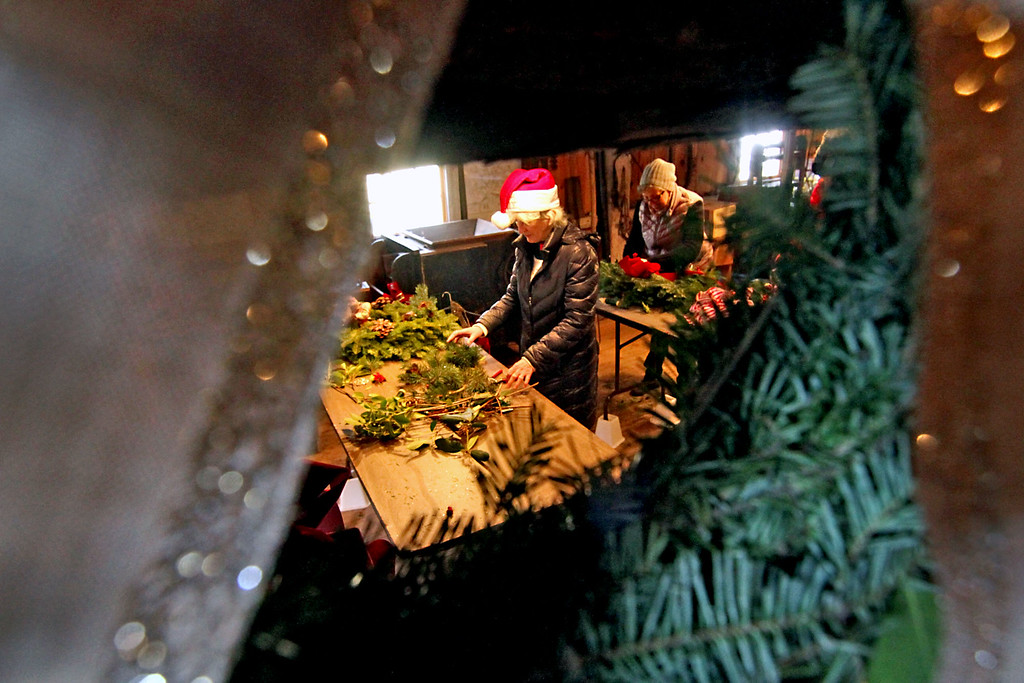 . Groton Womens Club members work on wreaths and swags for the annual Greens Sale. Nashoba Valley Voice /David H. Brow