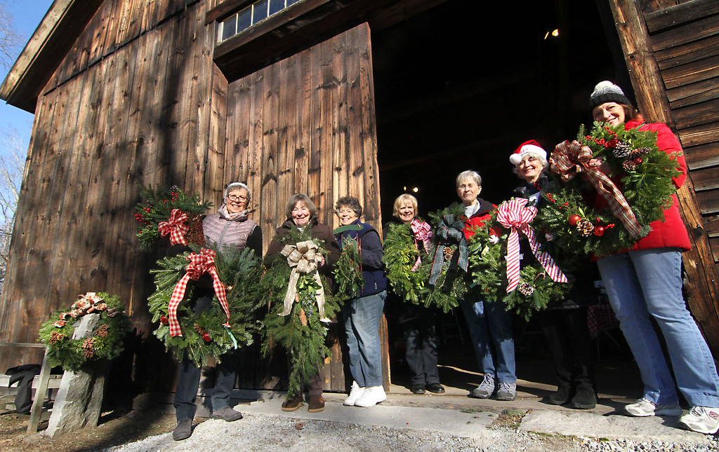 . Some of the members of the Groton Womens Club, show a handful of wreaths and swags they made for the sale at Williams Barn, L-R, Cindy Boyle, Nancy Olson, Peg Wheatley, Lois Berge, Pat Bennett, Ann Krajewski and Bridget Reiss, all from Groton. Nashoba Valley Voice /David H. Brow