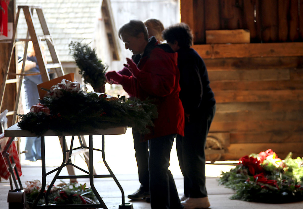 . Some members of the Groton Womens Club, working on wreaths and swags at the Williams Barn in Groton for their annual Greens Sale. Nashoba Valley Voice /David H. Brow