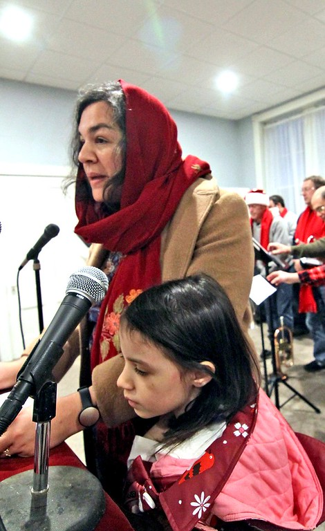 . Giving a reading from our Muslim neighbors is Nadia Madden and her daughter Laila Madden 6 from Groton. SUN/ David H. Brow