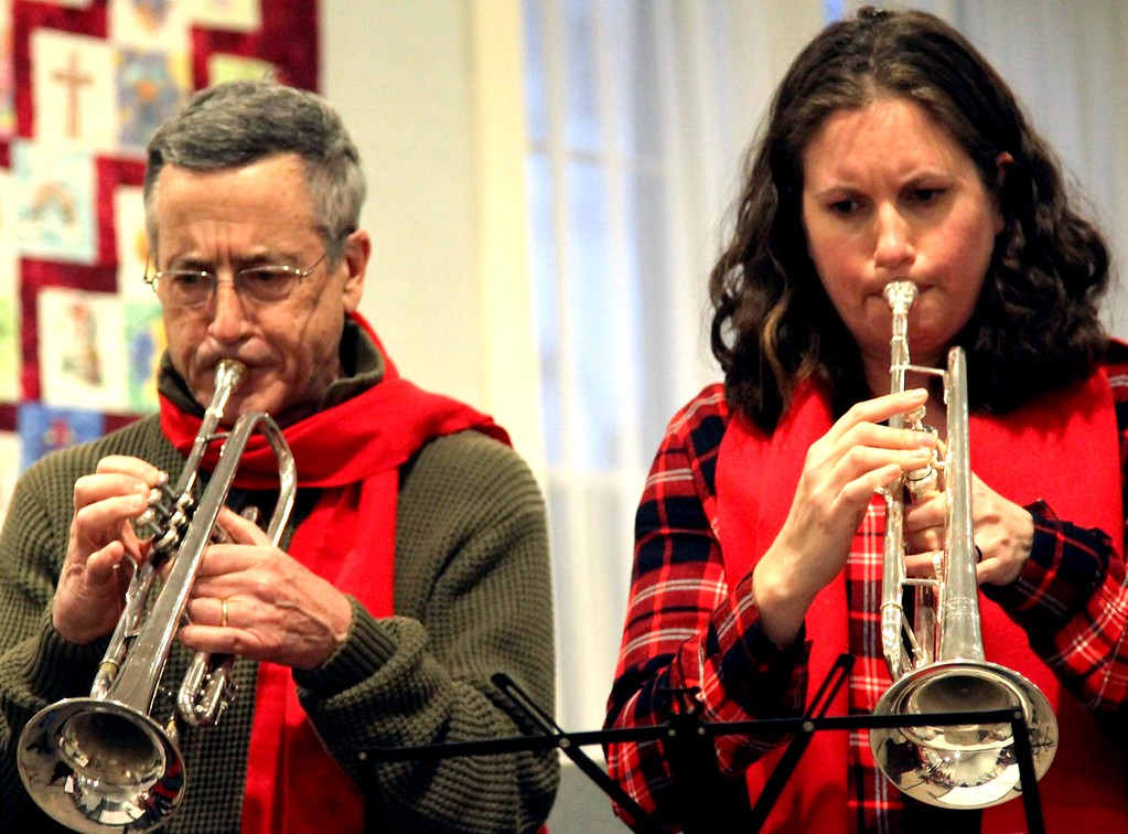 . Roger Cappallo and Becky Freeman, both from Groton, play music at the Groton Interfaith Council Community Tree Lighting. SUN/ David H. Brow
