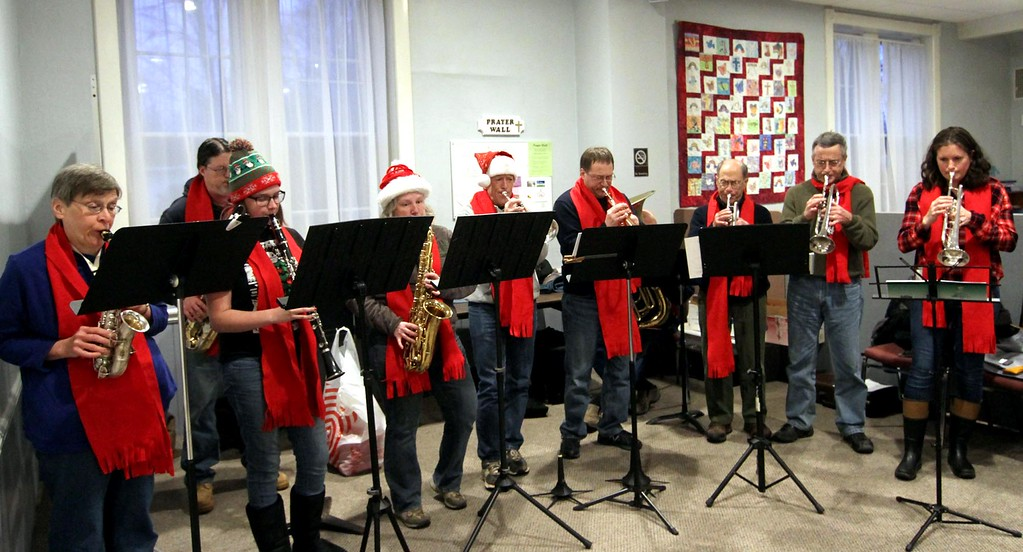 . Playing music at the Groton Interfaith Council Community Tree Lighting are members of the Groton Brass Ensemble & Nashoba ValleyConcert Band. SUN/ David H. Brow