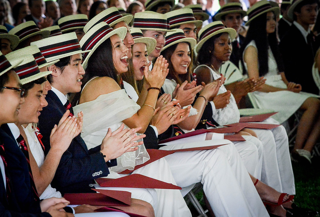 . Groton School graduates cheer and clap for their classmates as they receive their diploma. SUN/Caley McGuane
